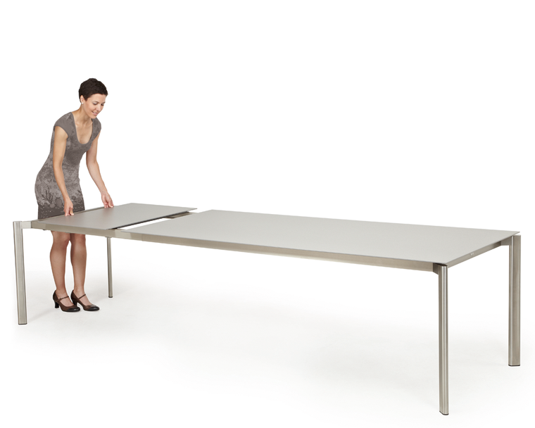 Swing front extension table